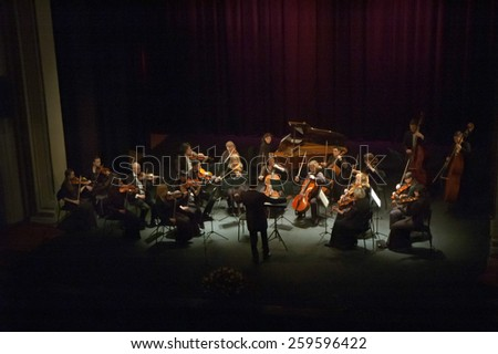 DNIPROPETROVSK, UKRAINE - MARCH 9: FOUR SEASONS Chamber Orchestra - main conductor Dmitry Logvin perform at the State Russian Drama Theatre on March 9, 2015 in Dnipropetrovsk, Ukraine #259596422