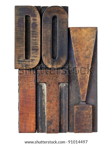 do it exclamation - motivation concept - isolated text in vintage wood letterpress printing blocks stained by color inks
