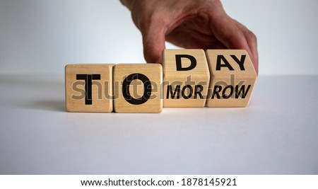 Do it today, not tomorrow. Male hand flips wooden cubes and changes the word 'tomorrow' to 'today'. Beautiful white background, copy space. Business and tomorrow or today concept. Stock photo ©