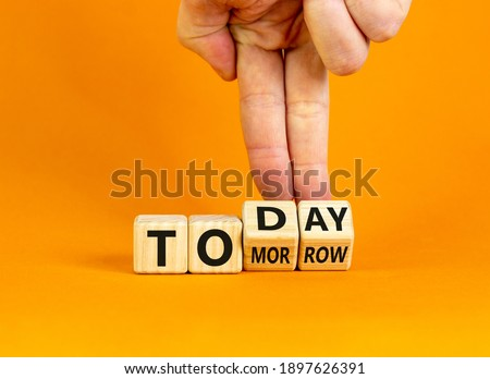 Do it today, not tomorrow. Male hand flips wooden cubes and changes the word 'tomorrow' to 'today'. Beautiful orange background, copy space. Business and tomorrow or today concept. Сток-фото ©