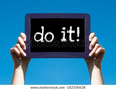 Do it ! Woman holding blackboard over blue background with text Do it !