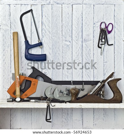 Do it Yourself (DIY) tools on workshop shelf; good copy space on white-painted wall