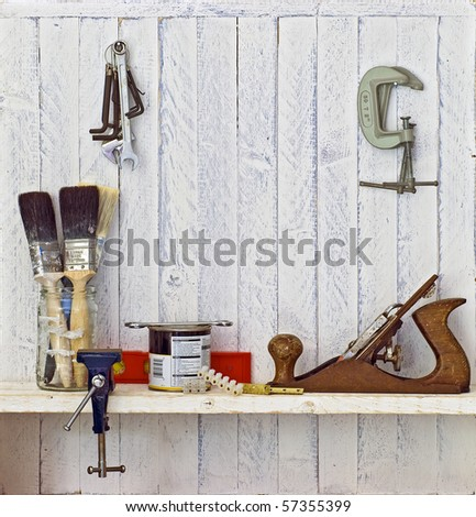 Do it Yourself (DIY) tools on workshop shelf --  good copy space on white-painted wall