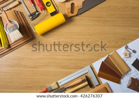Do it yourself home remodeling and renovation concept, work table top view with tools, house keys and wood swatches