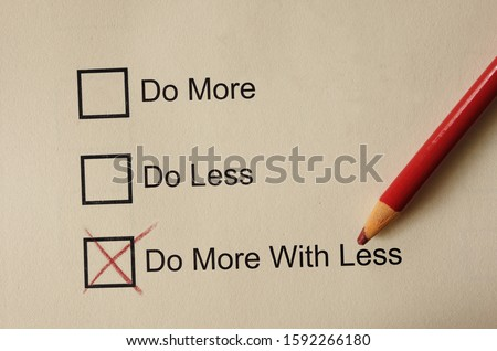 Photo of  Do More With Less check box with  red pencil, productivity concept