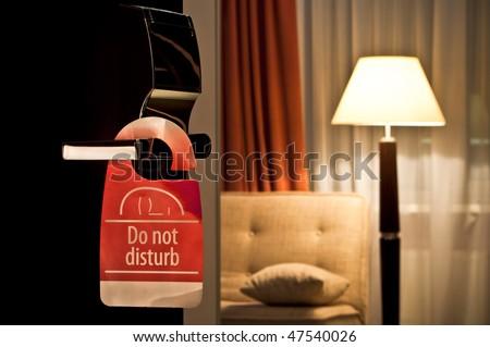 do not disturb sign hanging on open door in a hotel