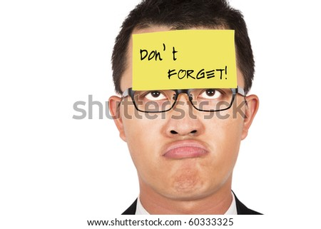 do not forget and keep in mind.young businessman helpless looking the post it