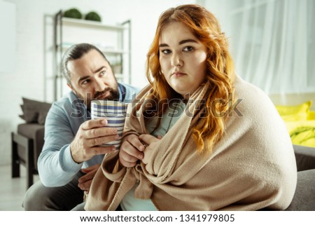 Do not like it. Angry plump woman having bad mod while being hungry