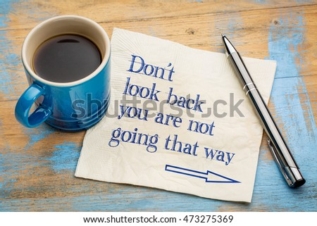 Do not look back  you are not going that way - handwriting on a napkin with a cup of espresso coffee #473275369