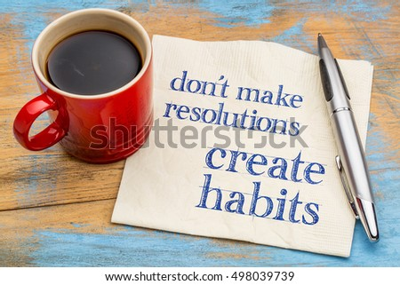 Do not make resolutions, create habits  - motivational advice or reminder on a napkin with a cup of coffee Stock photo ©