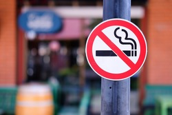 Do not smoking sign in front of seafood restaurant,selective focus