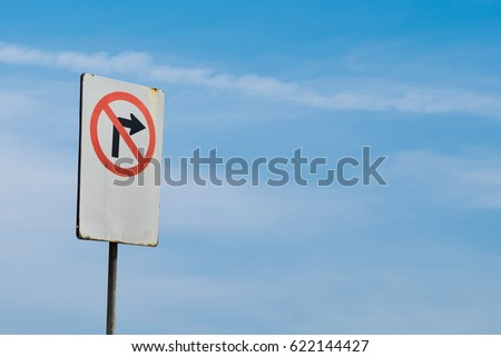 do not turn right sign on blue sky background