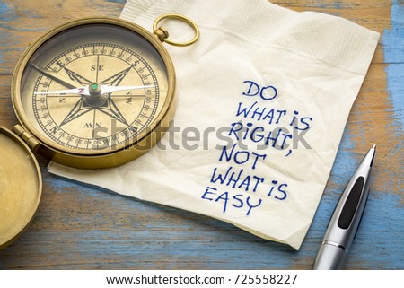 Do what is right, not what is easy  advice or reminder - handwriting on a napkin with an antique brass compass ストックフォト ©