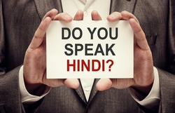 Do You Speak Hindi ? Man holding a card with a message text written on it