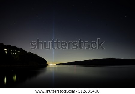 DOBBS FERRY, NY - SEPTEMBER 11 - The beams from Tribute in Light stretch high into the night sky over New York City on the eleventh anniversary of the 9/11 attacks, and are visible for miles. NYC Sept 11 2012 - stock photo