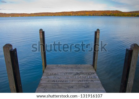 "Dock on waterfront in autumn, reading ""Danger, No Swimming"""