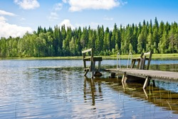 Dock or pier on lake in summer day. Finland