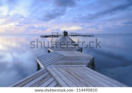Dock with wood in zig zag in the morning at Mar Menor, Spain