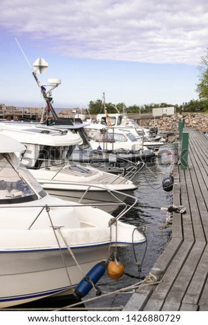 Docked boats. moored boats. Boats standing in a row at a wooden pier. Docked boats #1426880729