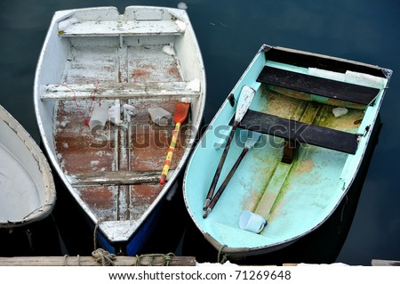 Docked Skiffs and rowboats in calm safe harbor waters
