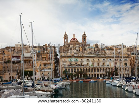 Docked yachts in Dockyard Creek of Senglea, Malta