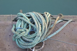 Dockside metal mooring ring for tying boats with nylon rope.