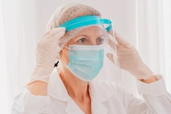Doctor adjust the face protector screen against covid-19 virus