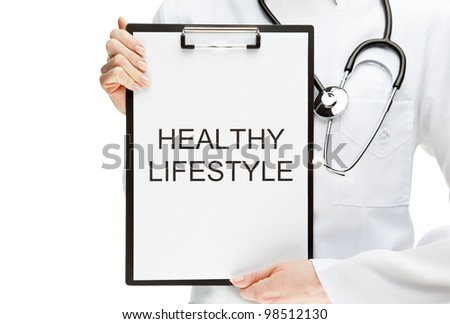 "Doctor advising healthy lifestyle; closeup of doctor's hands holding clipboard with ""Healthy lifestyle"" text isolated on white"