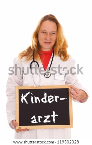 Doctor and a sign with the german word Pediatrician / Pediatrician
