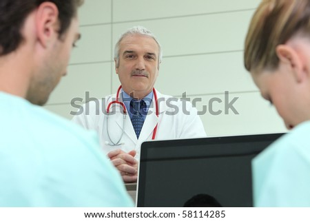 Doctor and caregivers