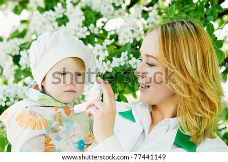 Doctor and child during spring allergic blossom dust season