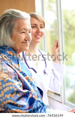 Doctor and her patient smiling