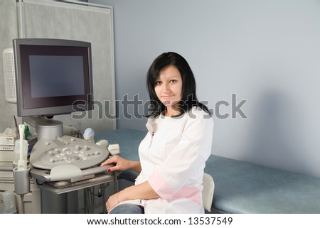 Doctor and modern ultrasound investigation equipment in antenatal maternity welfare clinic. - stock photo