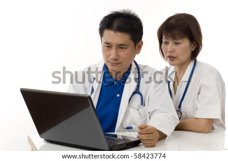 Doctor and Nurse checking patients records on computer