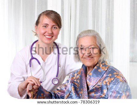Doctor and senior patient isolated - stock photo