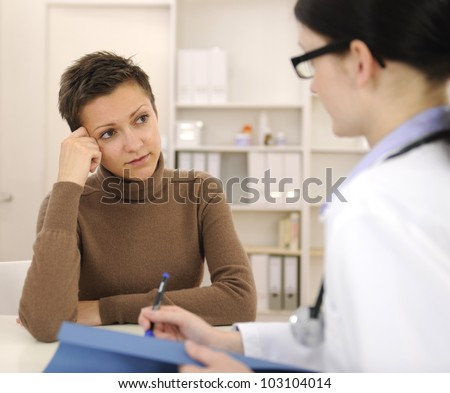 Doctor and worried patient at office  during consultation