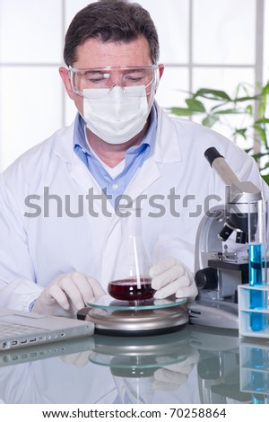doctor at laboratory blood examination