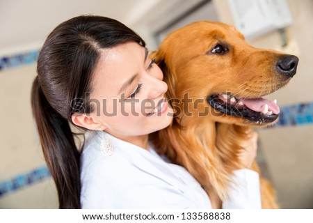 Doctor at the vet hugging a beautiful dog