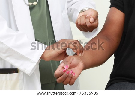 Doctor checking on a patient