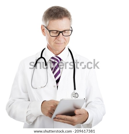 Doctor checking patient notes on a tablet-pc standing with his stethoscope around his neck reading the information on the screen isolated on white