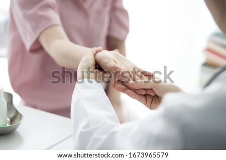 Doctor checking patient's hand pain Сток-фото ©