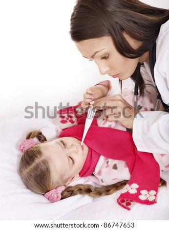 Doctor checking temperature of child.