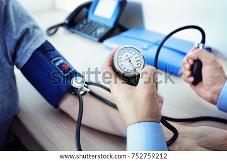 Doctor checking the blood pressure of a patient #752759212