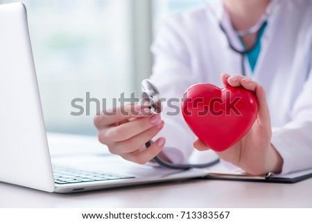 Doctor checking up heart in medical concept #713383567