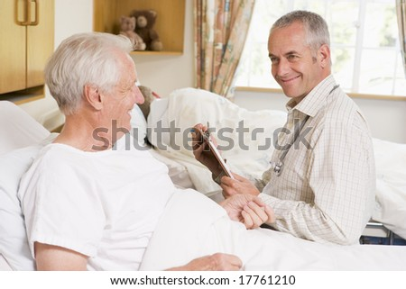 Doctor Checking Up On Senior Man In Hospital