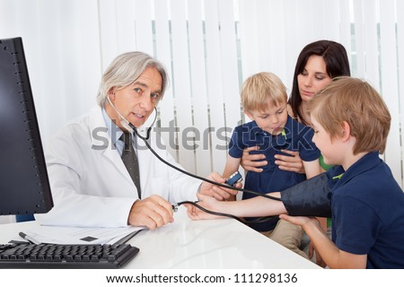 Doctor checking young kids at the office