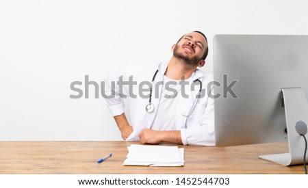 Doctor Colombian man suffering from backache for having made an effort