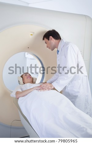 Doctor comforting patient before CT scan