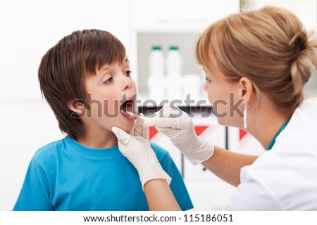 Doctor consulting a young boy - sore throat concept