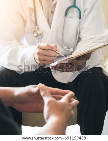 Doctor consulting male patient, working on diagnostic examination on men's health disease or mental illness, while writing on prescription record information document in clinic or hospital office